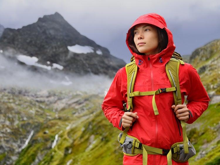 hiker on trail in rain