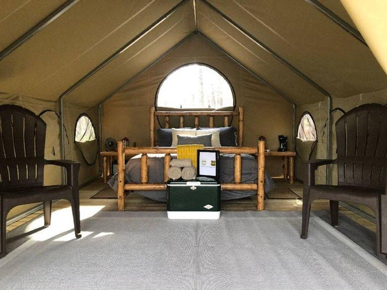 view from inside large, furnished glamping tent at Lake Powhatan, photo from a camper on The Dyrt