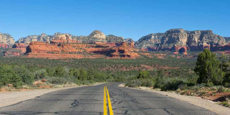 Road leading to red rock formations