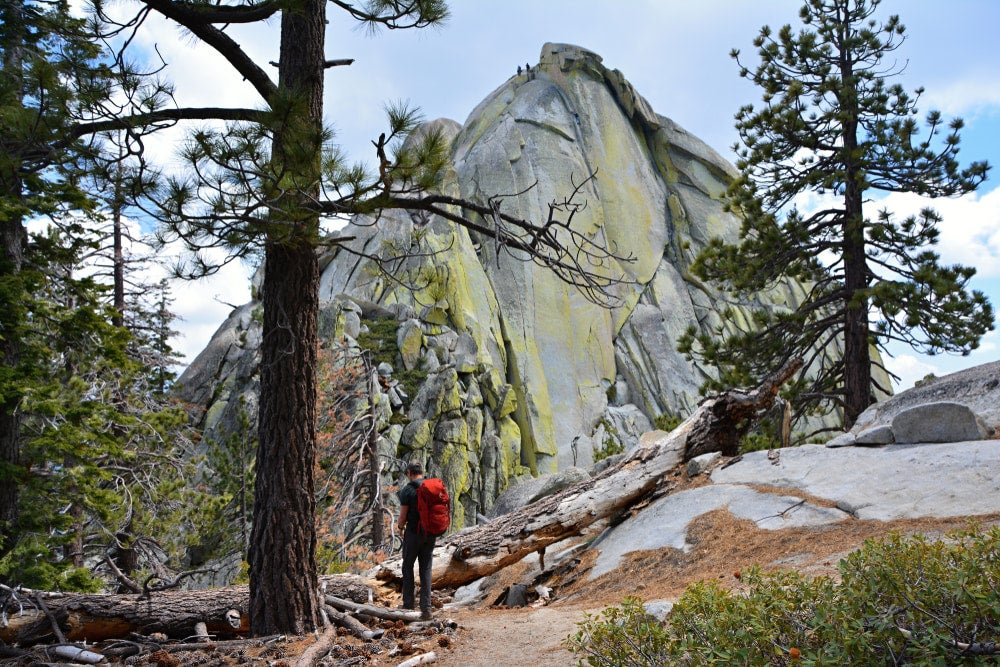 a hiker at the base of the needles in california