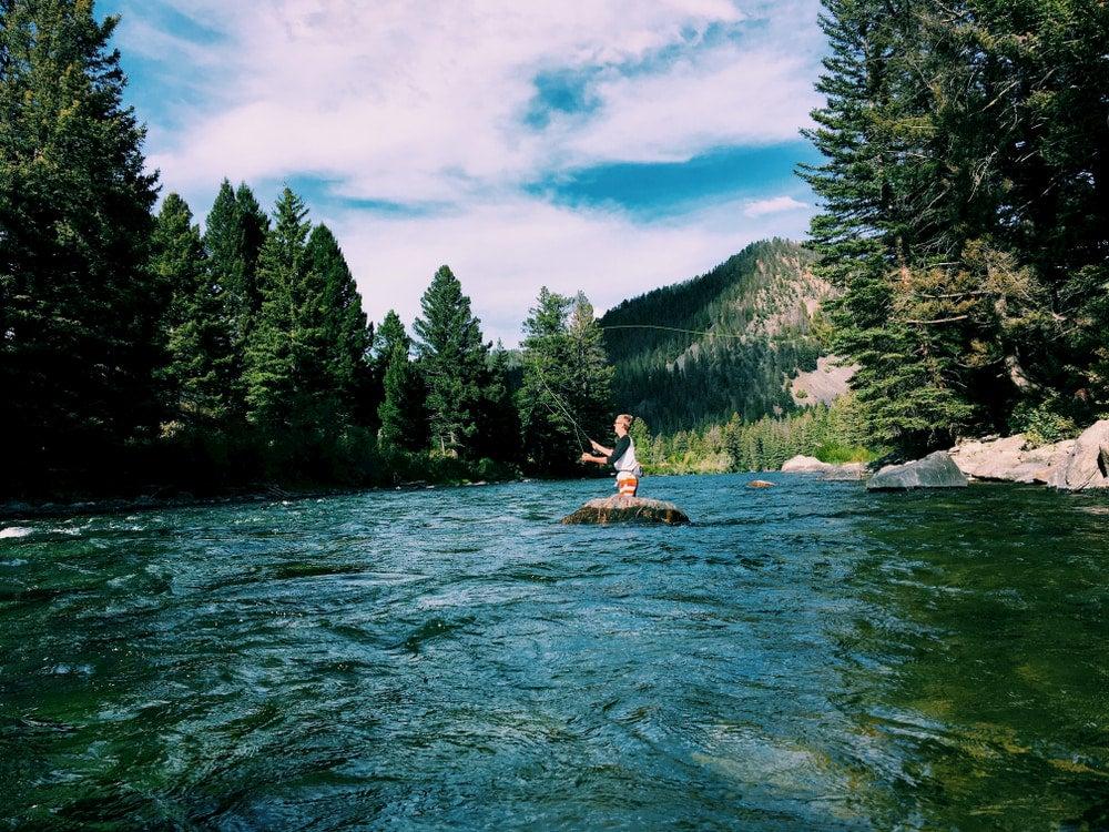 Man fishing in blue river