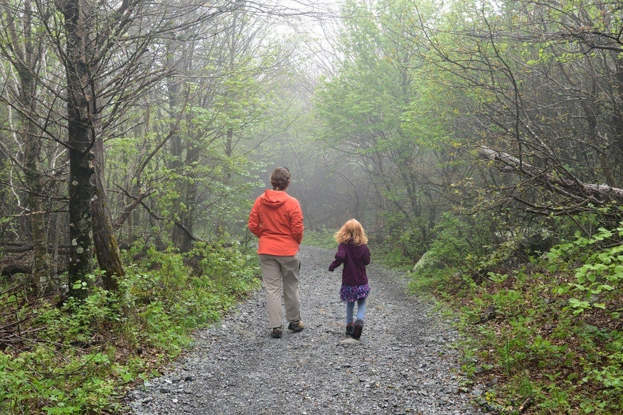 mother and daughter walk down foggy gravel path in Virginia's Big Meadows, photo from a camper on The Dyrt