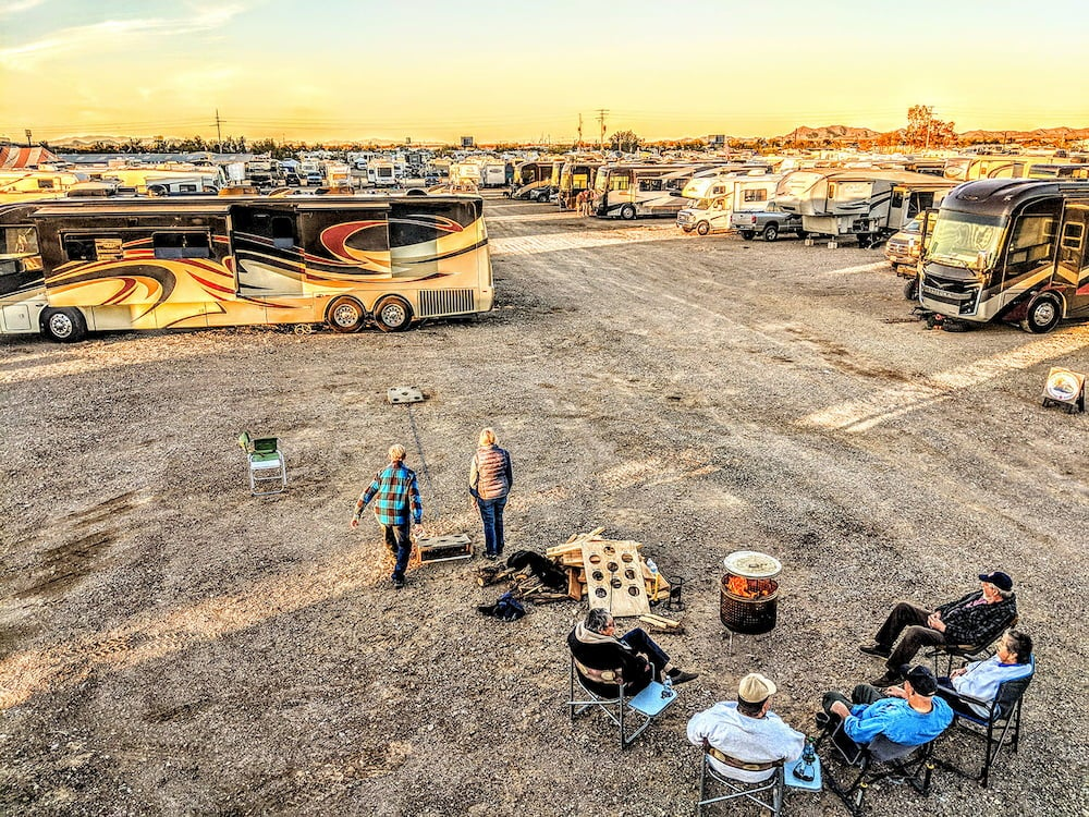 a group of campers play a game in a gravel RV lot in arizona