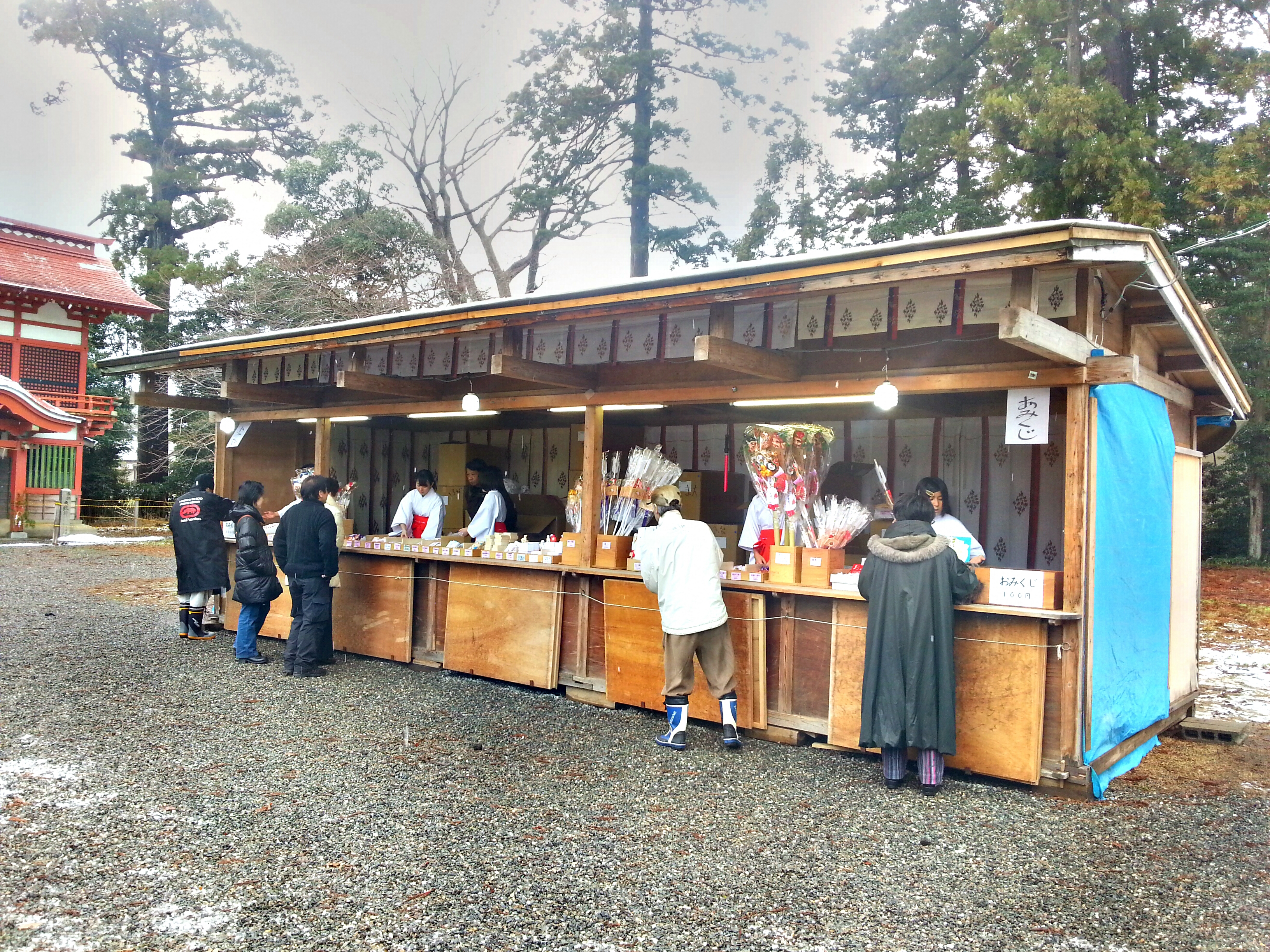 Visitors to Amatsu Shrine purchase protective charms and talismans