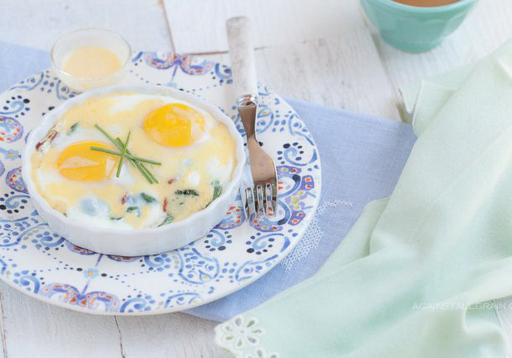 Baked-Eggs-with-Bacon-Greens-and-Hollandaise.jpg