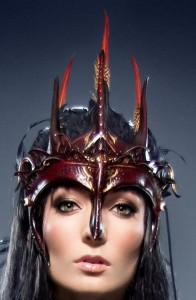 The Dark Faery Queen headdress is made of four segmented, lightweight leather pieces and can be configured in a variety of styles. Feathers decorate the crown and also flow down the back of this stunning headdress. Ragged Edge Leatherworks at CustomMade.com