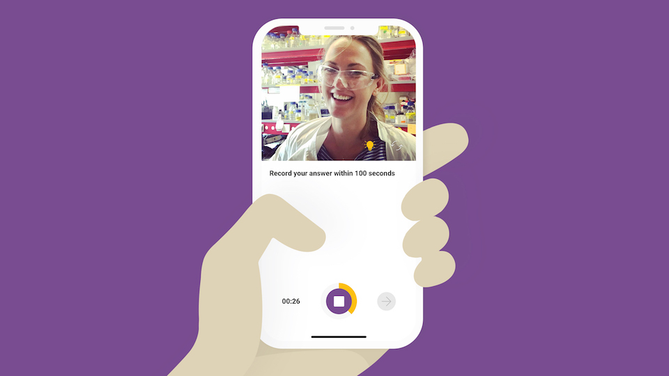 An illustrated hand holding an iPhone X that displays a mentor recording a video in the 100mentors app. On a purple background.