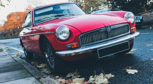 red antique car in the fall
