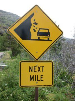 Rocks Falling Road Sign Next Mile