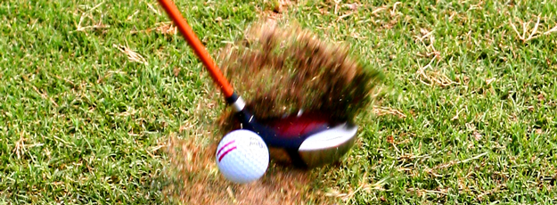 Swinging golf club takes chuck of dirt out of ground