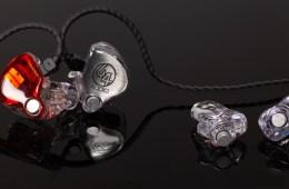 64 audio in-ear monitors and custom earplugs sitting on a reflective black background