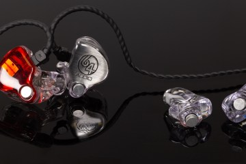64 audio in-ear monitors and custom earplugs sitting on a reflective black background