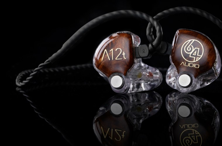 64 Audio A12t in-ear monitors with redwood burl wood faceplates on a black background