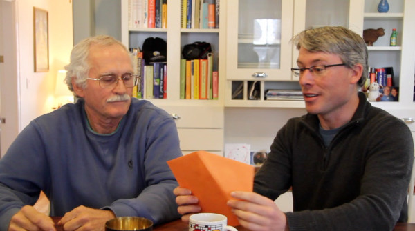 Jay Lehman, left, and Neil Hayward, right, opening the envelope that reveals the ABA's 2014 Bird of the Year