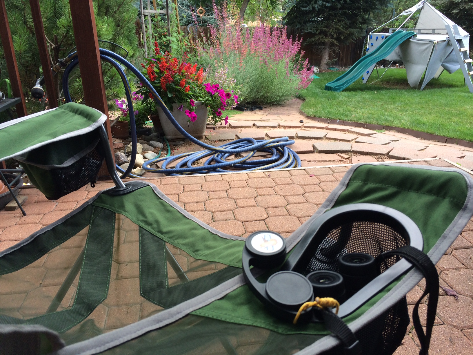rei camp x chair blue patio cushions proudly display your duck stamp aba blog s conveniently holds a pair of full sized binoculars in its