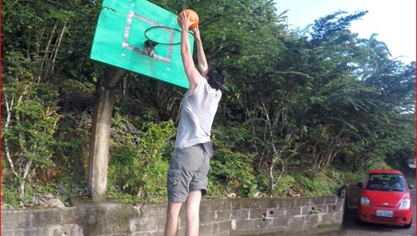 Rudy playing basketball