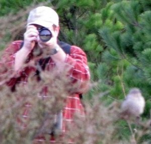 The author photographing a vagrant Sage Thrasher. Photo by Jeff Skrentny.