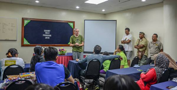 Participants in an NGO workshop discuss ways of engaging local economies in ecotourism. Photo by © Sulaiman Salikan.