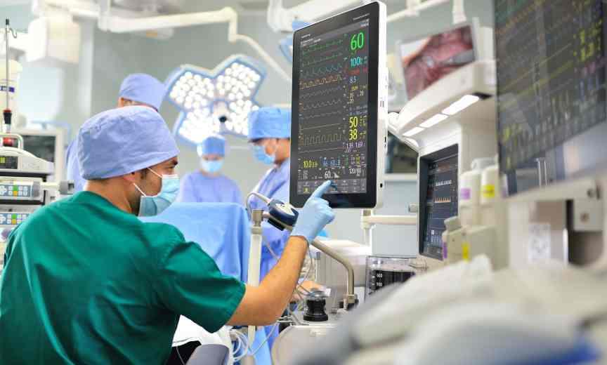 general surgeon checks readings