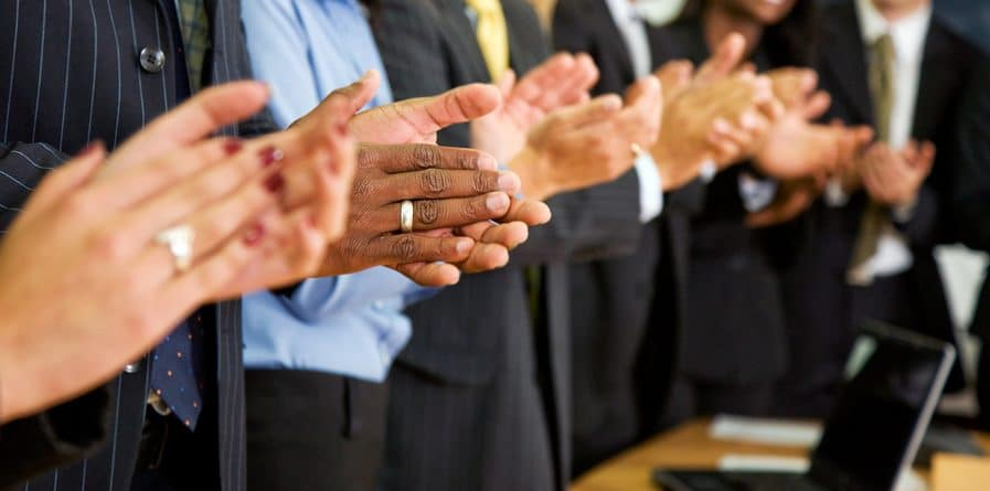 business team clapping in an office