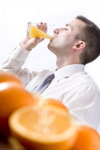 http://www.dreamstime.com/royalty-free-stock-photo-oranges-table-man-drinking-orange-juice-image26777565