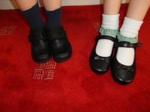 Children with different sized feet and matching shoes