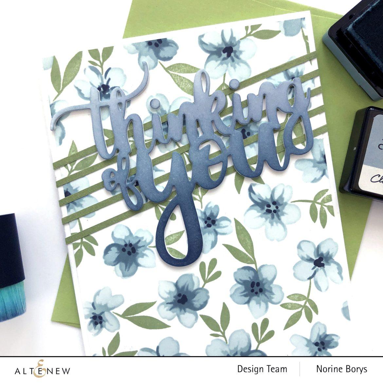 Handmade card using floral layering stencils
