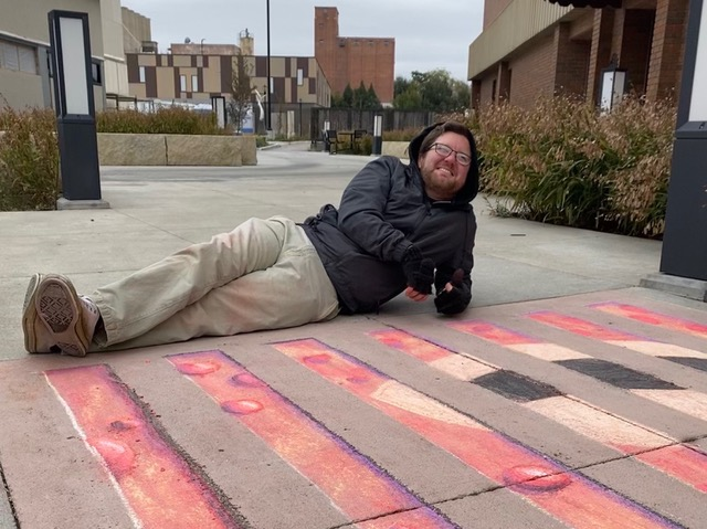 "Darren Morawitz working on his chalk installation, ""Kraken."""