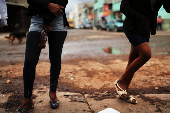 Sex workers wait for customers in Honduras (Photo Credit: Spencer Platt/Getty Images).