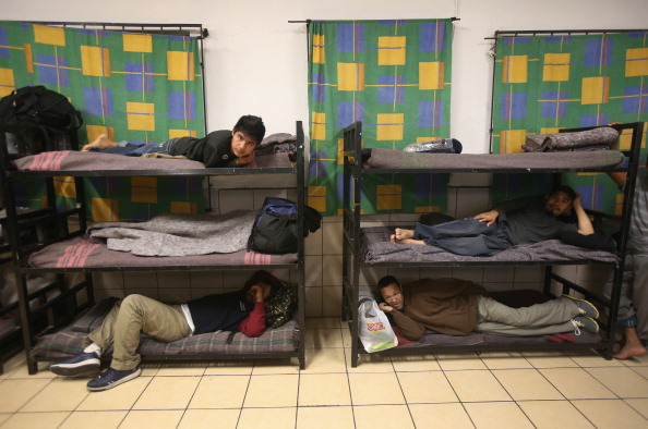 Immigrants prepare to sleep at the San Juan Bosco shelter. (Photo Credit: John Moore/Getty Images)