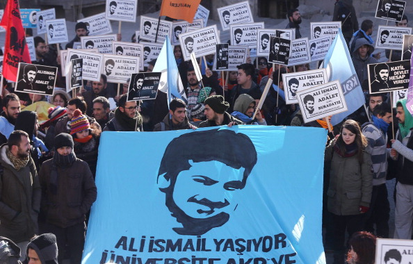 "Thousands of people, holding placards that read ""We are here for Ali Ismail and for justice"" gather outside a local courthouse (Photo Credit: Adem Altan/AFP/Getty Images)."