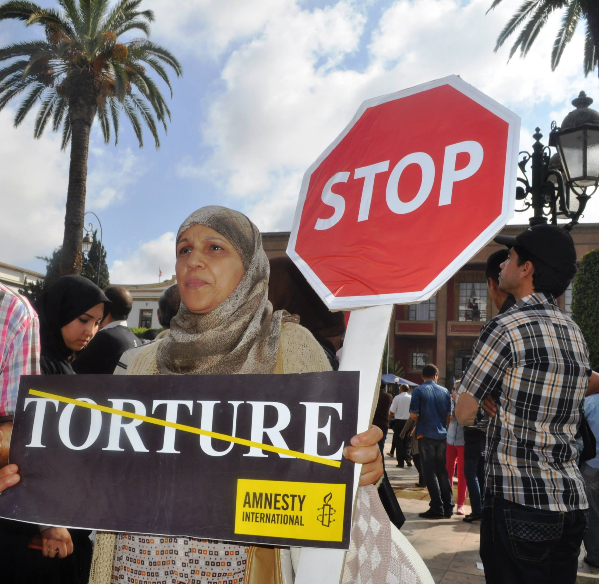 Some photos of some of AI Morocco actions on Stop Torture. Stop sign