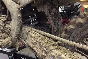 Dirt bike chain covered in mud