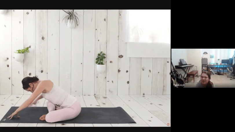 Tyler watches the instructional yoga video with a confused expression