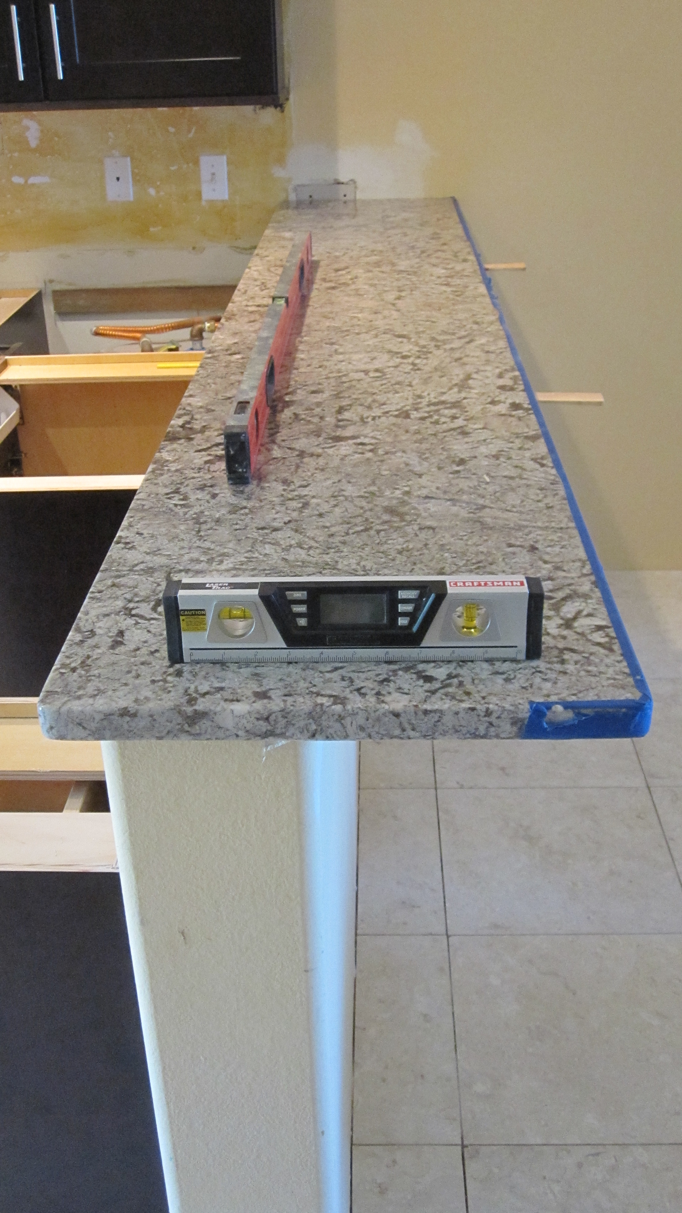kitchen counter overhang unique clocks granite limits for your countertops armchair bar top with