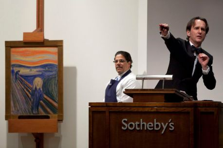 """Auctioneer takes bids for the sale of """"The Scream"""" painted by Edvard Munch at Sotheby's in New York"""