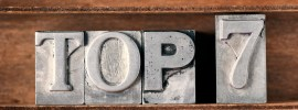 top 7 phrase made from metallic letterpress type on wooden tray