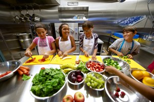Rossbrook House: Kids in the kitchen at Rossbrook House, supported by a grant from Nourishing Potential. Photo courtesy of The Winnipeg Foundation.