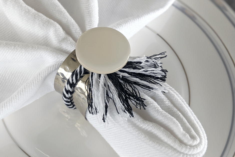Large white button tops silver napkin ring.