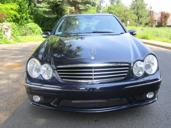 This 2006 C55 AMG is easily identified by the mesh grille on the lower fascia. It is borrowed from the CLK 55 AMG coupe, the double oval headlights are standard across the W203 line. Although the silver 5 bar silver grille is the signature style for these cars, a charcoal mesh unit can be fitted for a racier look.