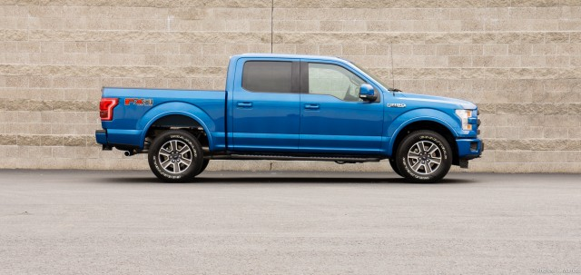 Side view of a blue Ford F-150