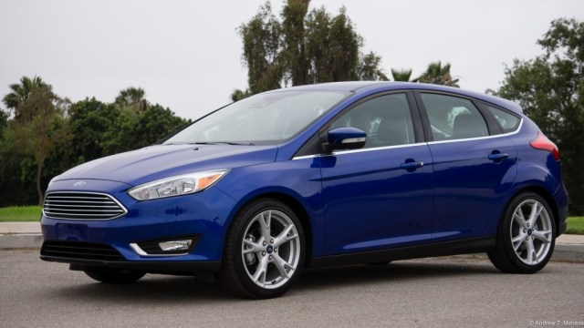 Dark Blue Ford Focus Hatchback parked in front of a golf course.