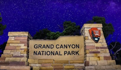 Grand Canyon, picture of the grand canyon national park sign under a star lit sky