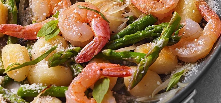 shrimp and gnocchi with asparagus, picture of shrimp and gnocchi with asparagus on a plate topped with cheese