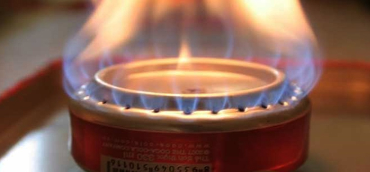 build a coke can stove, picture of a coke can stove on fire