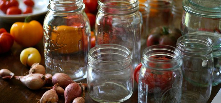 mason jar camping hacks, picture of mason jars sitting on a table with vegetables behind them