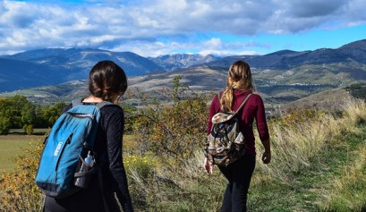 clear your mind, picture of to women hiking with back packs during a camping trip