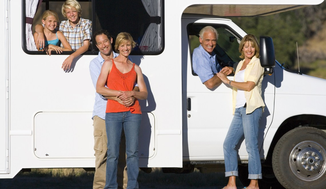Sharing an RV with a multi-generation family relaxing in countryside on motor home vacation