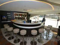 The stylish, semi-circular bar in the lounge is quiet ...