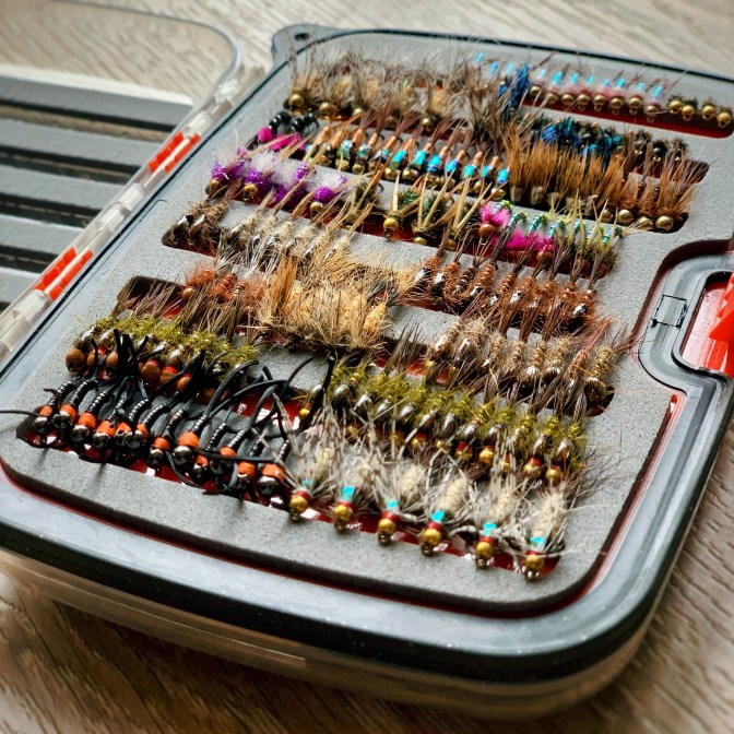 I decided I wanted to make a fly box just for nymphing. I would pick 1 pattern and tie up a bunch, before moving to the next pattern. I found it helped me get my proportions right, and I felt the most accomplished when all the flies started to look the same. This box is not quite full, but it did take some time to build. But time flies when you're having fun sitting in front of a vise.